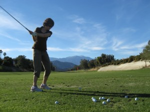 Sue swinging at the Chaparral Driving Range