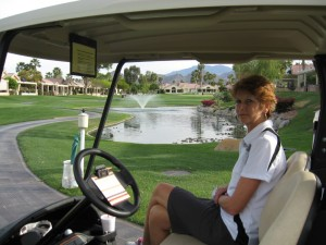 Sue in the golf cart at Oasis Golf Club