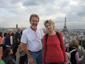 Rudy and Sue at the top of the Arc de Triomphe, with the Eiffel Tower in the distance.