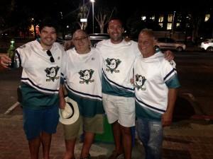 4 rugby guys in Anaheim Mighty Duck jerseys.