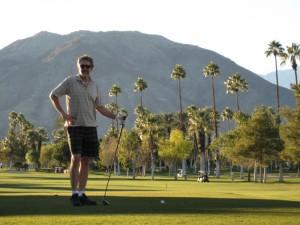 Sue with a golf club.