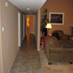 Long hallway from dining room, past bedrooms, to the garage.