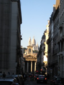 "The Sacre Couer, as seen from Rue de Martyrs, ""our"" street."