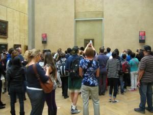 photographers crowd around the Mona Lisa