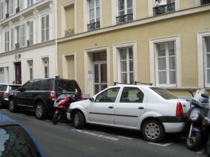 Parking in Paris -- let's put another motorcycle in that empty space between the bumpers.