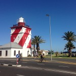 Cyclists in front of the Moulle Point lighthouse.