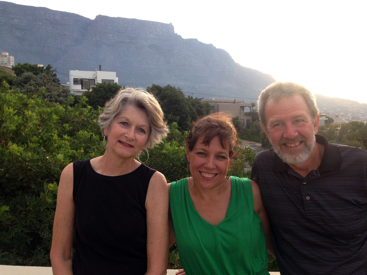 Sue, Marina, and Rudy, with the sun setting against Table Mountain (and the ocean breeze messing up some hair-dos).