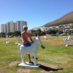 Sue on a rocking horse on the Sea Point Promenade.