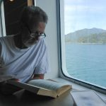 Rudy reading on the ferry